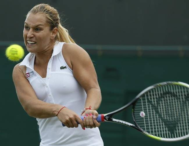 Domimika Cibulkova of Slovakia returns to Lucie Safarova of the Czech Republic during their women's singles match at the All England Lawn Tennis Championships in Wimbledon, London, Friday, June 27, 2014