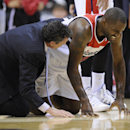 Washington Wizards forward Martell Webster, right, reacts after he was injured during the first half of an NBA basketball game against the Milwaukee Bucks, Friday, Dec. 6, 2013, in Washington The Associated Press