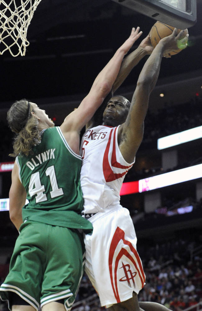 Houston Rockets' Terrence Jones, right, tries to shoot over Boston Celtics' Kelly Olynyk (41) in the second half of an NBA basketball game Tuesday, Nov. 19, 2013, in Houston. The Rockets won 109-85