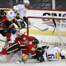 Nashville Predators' Shea Webber (6) scores on Calgary Flames goalie Joni Ortio, of Finland, during the first period of an NHL hockey game in Calgary, Alberta, Friday, March 21, 2014 The Associated Press
