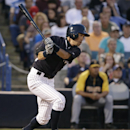New York Yankees Ichiro Suzuki hits a second-inning single in a spring exhibition baseball game against the Pittsburgh Pirates in Tampa, Fla., Friday, March 21, 2014 The Associated Press