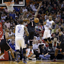 Orlando Magic point guard Jameer Nelson (14) passes to Kyle O'Quinn (2) against Miami Heat center Chris Bosh (1) during the first half of an NBA basketball game in Miami, Saturday, March 1, 2014 The Associated Press