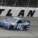 Jimmie Johnson (48) drives through Turn 4 during the NASCAR Sprint Cup series auto race at Atlanta Motor Speedway, Sunday, March 1, 2015, in Hampton, Ga. (AP Photo/John Bazemore)