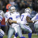 Dallas Cowboys' Tony Romo looks to pass during the second half of an NFL football game against the Philadelphia Eagles, Sunday, Dec. 14, 2014, in Philadelphia The Associated Press