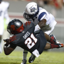 North Carolina State running back Matt Dayes (21) dives in on a 10-yard touchdown run as Old Dominion cornerback Phil Paulhill (17) defends during an NCAA college football game at Carter-Finley Stadium in Raleigh, N.C., Saturday, Sept. 6, 2014 The Associa