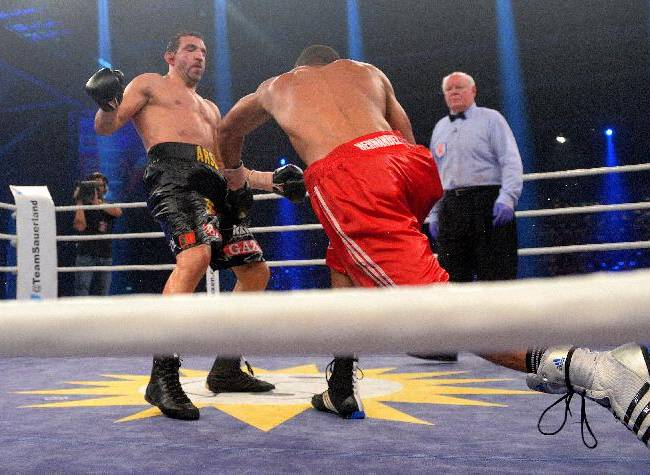 In this picture taken Saturday Aug. 16, 2014, Cuban  boxer Yoan Pablo Hernandez, right,  punches Germany's Firat Arslan  during their IBF Cruiserweight title bout in Erfurt, eastern Germany.   Yoan Pablo Hernandez of Cuba retained his IBF cruiserweight title by split decision over German challenger Firat Arslan on Saturday