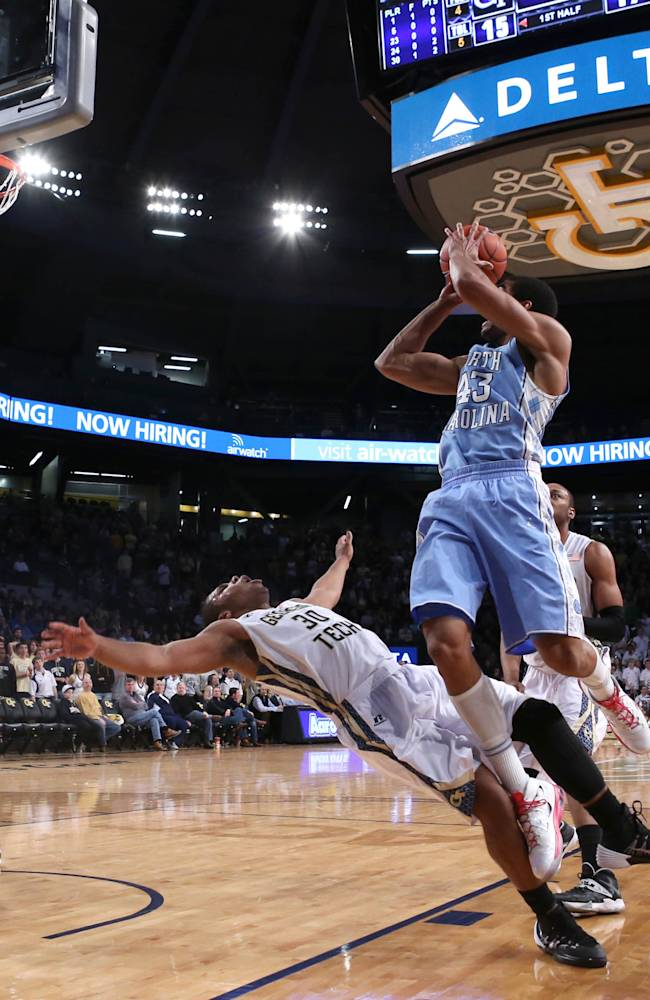North Carolina forward James Michael McAdoo (43) attempts a shot as he is fouled by Georgia Tech guard Corey Heyward (30) during the first half of an NCAA college basketball game, Wednesday, Jan. 29, 2014, in Atlanta. Heyward was attempting to get a charge from Michael McAdoo