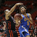 UCLA guard Kyle Anderson (5) lays the ball up as Utah forward Jordan Loveridge (21) defends during the first half of an NCAA basketball game, Thursday, Jan. 10, 2013, in Salt Lake City. (AP Photo/Rick Bowmer)