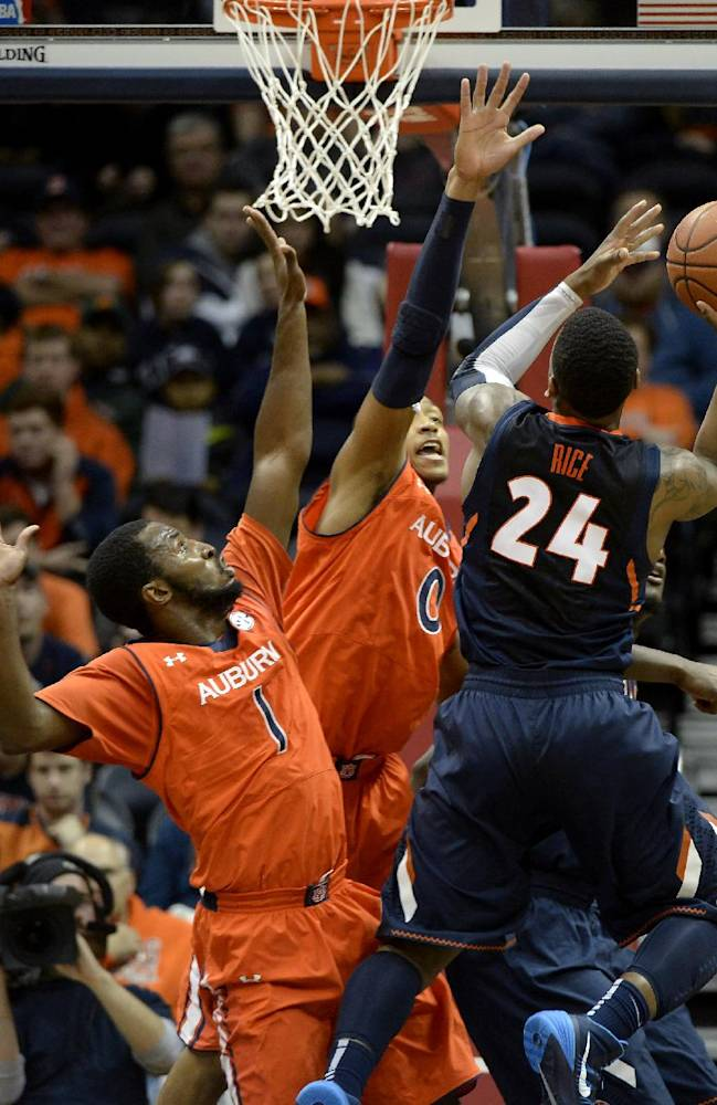 Illinois guard Rayvonte Rice (24) shoots over Auburn's KT Harrell (1) and Asauhn Dixon-Tatum (0) in the first half of an NCAA college basketball game on Sunday, Dec. 8, 2013, in Atlanta