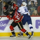 Tampa Bay Lightning's Valtteri Filppula, right, from Finland, checks Calgary Flames' Brandon Bollig during the first period of an NHL hockey game Tuesday, Oct. 21, 2014, in Calgary, Alberta The Associated Press