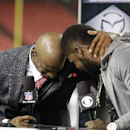 NFL Network broadcaster and former NFL football player Deion Sanders, left, embraces Atlanta Falcons wide receiver Devin Hester after the second half of an NFL football game, Thursday, Sept. 18, 2014, in Atlanta. The Atlanta Falcons won 56-14 The Associat