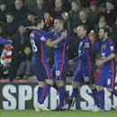 Manchester United's Robin Van Persie, center, celebrates with teammate Paddy McNair after scoring the opening goal of the game during their English Premier League soccer match between Southampton and Manchester United at St Mary's stadium in Southampton,