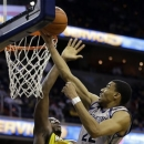 Georgetown forward Otto Porter Jr. (22) shoots over Marquette center Chris Otule (42) during the second half of an NCAA college basketball game, Monday, Feb. 11, 2013, in Washington. Porter had 21 points, and Georgetown won 63-55. (AP Photo/Alex Brandon)