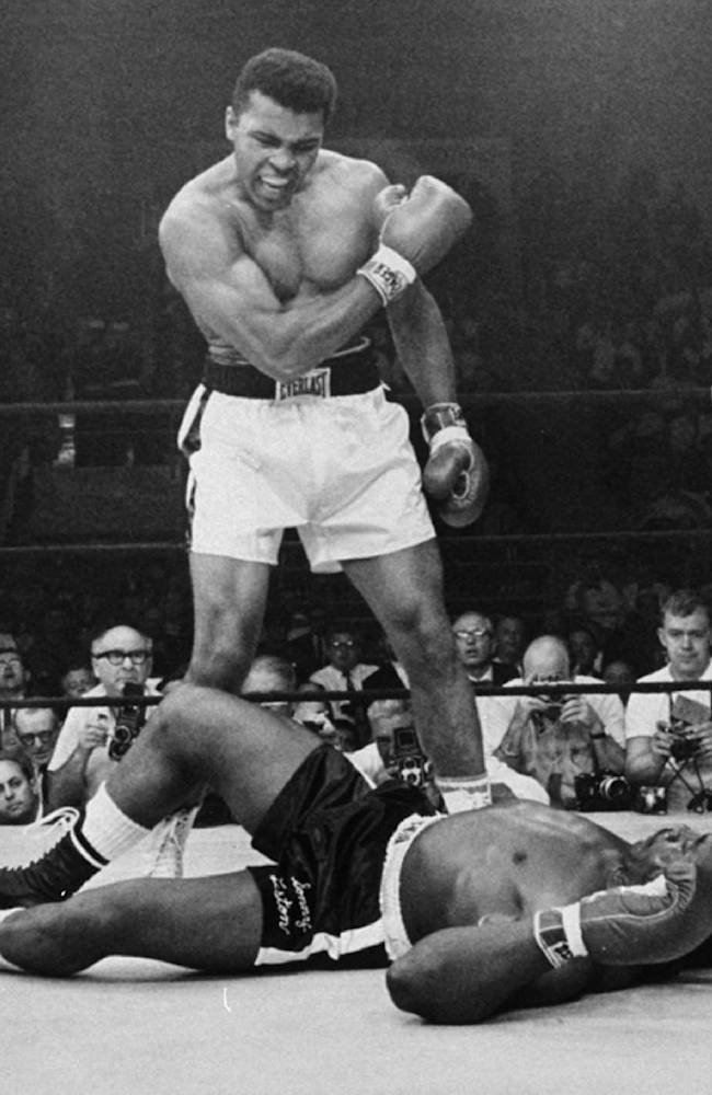 In this May 25, 1965 file photo, heavyweight boxing champion Muhammad Ali stands over fallen challenger Sonny Liston in Lewiston, Maine. He is now so much a part of the nation's social fabric that it's hard to comprehend a time when Ali was more reviled than revered