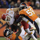 Kansas City Chiefs tight end Anthony Fasano (80) is tackled by Denver Broncos defensive end Malik Jackson (97) and outside linebacker Danny Trevathan (59) in the fourth quarter of an NFL football game, Sunday, Nov. 17, 2013, in Denver The Associated Press