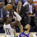 Indiana Pacers center Roy Hibbert, left, hits a shot over New York Knicks center Tyson Chandler during the second half of Game 3 of the Eastern Conference semifinal NBA basketball playoff series in Indianapolis, Saturday, May 11, 2013. (AP Photo/Michael Conroy)