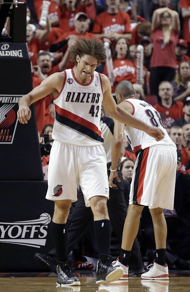 Portland Trail Blazers' Robin Lopez (42) reacts after fouling in the second half during Game 3 of a Western Conference semifinal NBA basketball playoff series against the San Antonio Spurs, Saturday, May 10, 2014, in Portland, Ore. The Spurs won 118-103
