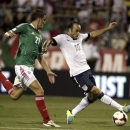 United States' Landon Donovan (10) fights for the ball with Mexico's Hiram Mier (21) during the first half of their 2014 World Cup qualifying soccer match in Columbus, Ohio September 10, 2013. REUTERS/Matt Sullivan