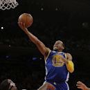 Golden State Warriors' Andre Iguodala (9) shoots over New York Knicks' J.R. Smith (8) during the second half of an NBA basketball game on Friday, Feb. 28, 2014, in New York The Associated Press