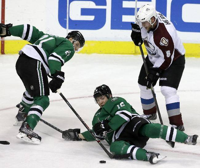 Dallas Stars left wing Antoine Roussel (21), of France, and Ryan Garbutt (16) attempt to gain control of a loose puck in front of Colorado Avalanche's Jan Hejda (8), of Czech Republic, in the third period of an NHL hockey game, Monday, Jan. 27, 2014, in Dallas. The Avalanche won 4-3