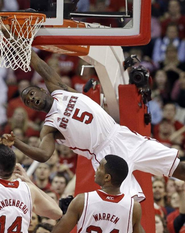 North Carolina State's Desmond Lee (5) misses a dunk against North Carolina during the second half of an NCAA college basketball game in Raleigh, N.C., Wednesday, Feb. 26, 2014. North Carolina won 85-84 in overtime