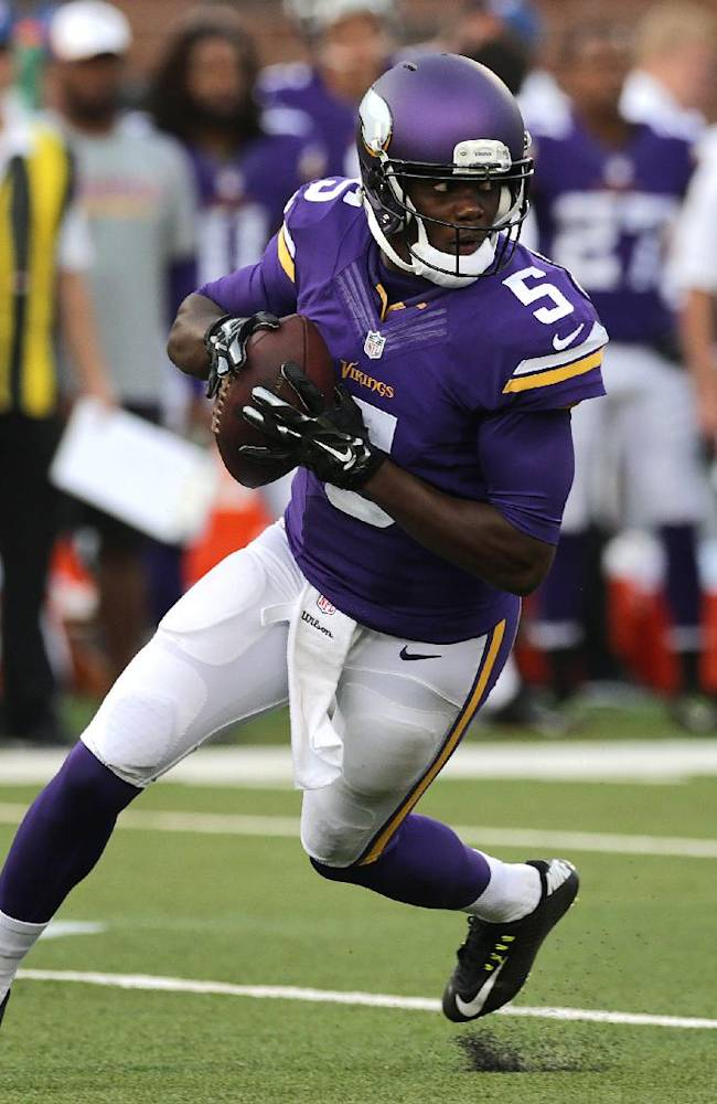 Minnesota Vikings quarterback Teddy Bridgewater (5) rolls out against the Oakland Raiders in the first half of a preseason NFL football game in Minneapolis, Friday, Aug. 8, 2014