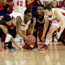 Dayton's Olivia Applewhite (4) gets control of the ball as St. John's Ashley Perez (11), Shenneika Smith (35) and teammate Andrea Hoover (24) fight for the ball during the first overtime period of a first-round game in the women's NCAA college basketball tournament Sunday, March 24, 2013, in New York. Dayton won the game 96-90. (AP Photo/Frank Franklin II)