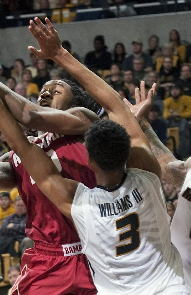 Missouri's Tony Criswell (2) and Johnathan Williams III (3) try to block the shot of Alabama's Levi Randolph, left, during the second half of an NCAA college basketball game, Saturday, Jan. 18, 2014, in Columbia, Mo. Missouri won the game 68-47