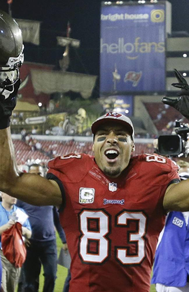 Tampa Bay Buccaneers wide receiver Vincent Jackson celebrates as he leaves the field after defeating the Miami Dolphins 22-19 in an NFL football game in Tampa, Fla., Tuesday, Nov. 12, 2013