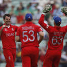 England's James Anderson, left, celebrates the wicket of South Africa's Colin Ingram by lbw with teammates during their ICC Champions Trophy semifinal cricket match at the Oval cricket ground in London, Wednesday, June 19, 2013. (AP Photo/Sang Tan)