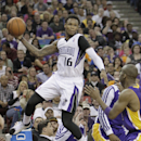 Sacramento Kings guard Ben McLemore, left, saves the ball from going out of bounds, as Los Angeles Lakers guard Jodie Meeks watches during the third quarter of an NBA basketball game Wednesday, April 2, 2014, in Sacramento, Calif. The Kings won 107-102 Th