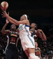 New York Liberty's Plenette Pierson (23) goes up against Connecticut Sun's Tina Charles (31) and Asjha Jones during the first half of their WNBA basketball game, Saturday, May 19, 2012, at Madison Square Garden in New York. (AP Photo/Mary Altaffer)