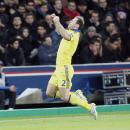 Chelsea's Branislav Ivanovic celebrates scoring the opening goal during the Champions League round of 16 first leg soccer match between Paris Saint Germain and Chelsea at the Parc des Princes stadium in Paris, France, Tuesday, Feb. 17, 2015. (AP Photo/Mic