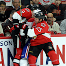 Ottawa Senators' Chris Neil, left, and Milan Michalek sandwich Montreal Canadiens' Jarred Tinordi during the second period of a preseason NHL hockey game in Ottawa, Ontario, on Friday, Oct. 3, 2014 The Associated Press