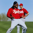 Cincinnati Reds pitcher Johnny Cueto plays around with teammates during spring training baseball practice in Goodyear, Ariz., Saturday, Feb. 15, 2014 The Associated Press
