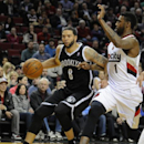 Brooklyn Nets' Deron Williams (8) drives against Portland Trail Blazers' Dorell Wright (1) during the first half of an NBA basketball game in Portland, Ore., Wednesday, Feb. 26, 2014 The Associated Press