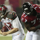Tampa Bay Buccaneers quarterback Josh McCown (12) runs out of the pocket as Atlanta Falcons defensive end Ra'Shede Hageman (77) pursues during the first half of an NFL football game, Thursday, Sept. 18, 2014, in Atlanta The Associated Press