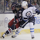 Columbus Blue Jackets' Artem Anisimov, left, of Russia, and Winnipeg Jets' Jacob Trouba fight for a loose puck during the second period of an NHL hockey game Tuesday, Nov. 25, 2014, in Columbus, Ohio The Associated Press