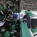 St. Louis Blues left wing Joakim Lindstrom (10) is knocked onto the bench by Dallas Stars center Shawn Horcoff (10) as defenseman Brenden Dillon, left, tries to get out of the way during the first period of an NHL hockey game, Tuesday, Oct. 28, 2014, in D