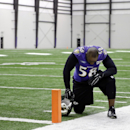 Baltimore Ravens outside linebacker Elvis Dumervil pauses at the edge of the field after an NFL football practice, Wednesday, Jan. 7, 2015, in Owings Mills, Md. The Ravens will travel to New England for a divisional playoff game against the Patriots on Sa