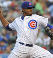 Chicago Cubs' Edwin Jackson pitches against the Milwaukee Brewers during the first inning of a baseball game, Wednesday, July 31, 2013, in Chicago. (AP Photo/David Banks)