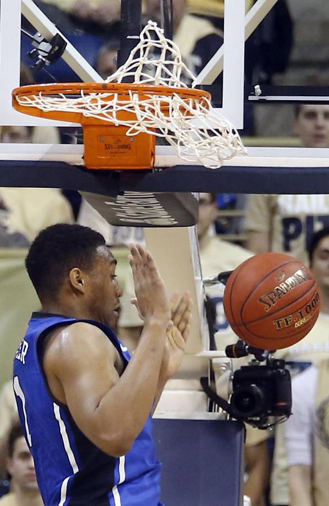 Duke's Jabari Parker finishes off a dunk against Pittsburgh during the first half of an NCAA college basketball game on Monday, Jan. 27, 2014, in Pittsburgh