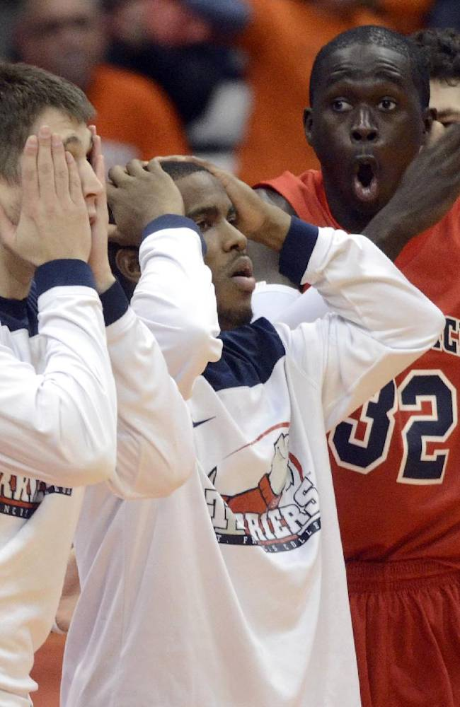 In this Nov. 18, 2013 file photo, St. Francis players react after Syracuse blocks a shot late in the second half of an NCAA college basketball game in Syracuse, N.Y., Monday, Nov. 18, 2013. Syracuse won 56-50. Even after beating Miami, St. Francis wasn't expected to be much of a match for the ninth-ranked Orange, who hadn't lost a nonconference home game since 2008