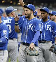 Kansas City Royals' Eric Hosmer, center, and teammates celebrate their 2-1 win over the Detroit Tigers in a baseball game in Detroit, Wednesday, June 18, 2014. It was the Royals' 10th straight win. (AP Photo/Carlos Osorio)