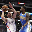 Los Angeles Clippers guard J.J. Redick, left, looks to shoot as Denver Nuggets guard Aaron Brooks defends during the first half of an NBA basketball game, Tuesday, April 15, 2014, in Los Angeles The Associated Press