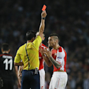 Arsenal's Mathieu Debuchy is given a red card during a second leg Champions League qualifying soccer match between Arsenal and Besiktas at Emirates Stadium in London Wednesday, Aug. 27, 2014.(AP Photo/Kirsty Wigglesworth)