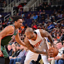 PHOENIX, AZ - DECEMBER 15: P.J. Tucker #17 of the Phoenix Suns is guarded by Jabari Parker #12 of the Milwaukee Bucks on December 15, 2014 at U.S. Airways Center in Phoenix, Arizona. (Photo by Barry Gossage/NBAE via Getty Images)