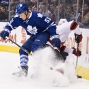 Toronto Maple Leafs defenseman Jake Gardiner (51) tries to check New Jersey Devils forward Jacob Josefson, right, during the first period of an NHL hockey game, Thursday, Dec. 4, 2014 in Toronto The Associated Press
