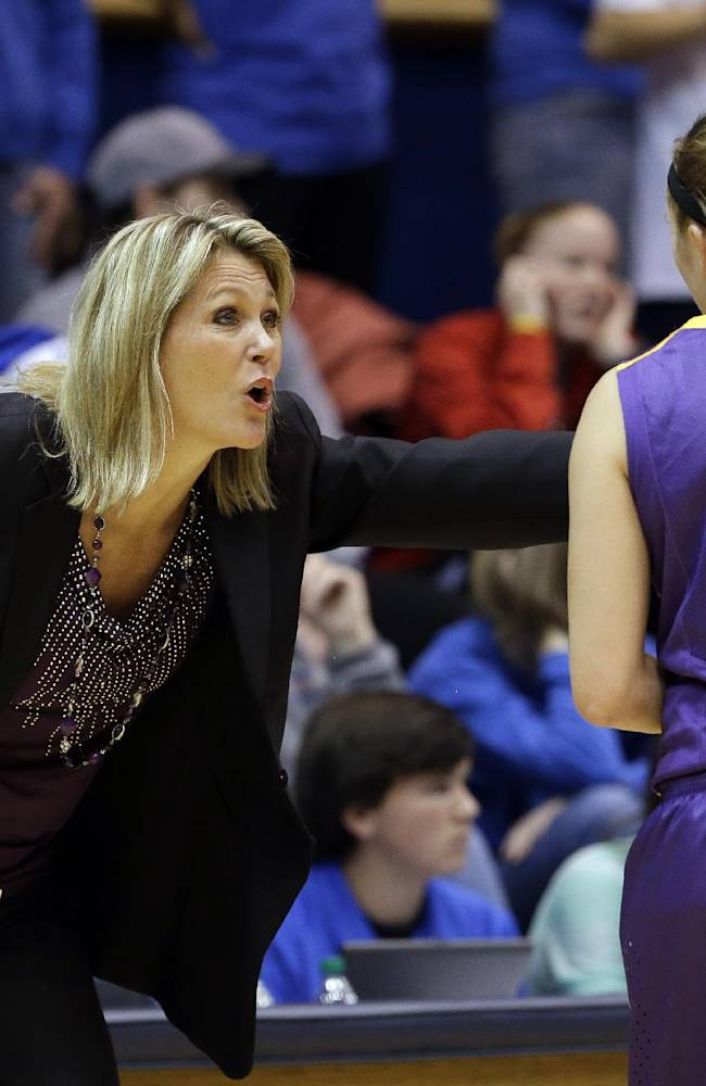 Albany coach Katie Abrahamson-Henderson, left, speaks with Sarah Royals (4) during the first half of an NCAA college basketball game against Duke in Durham, N.C., Thursday, Dec. 19, 2013. Duke won 80-51