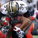 New Orleans Saints defensive end Cameron Jordan (94) wraps up Tampa Bay Buccaneers running back Doug Martin in the first half of an NFL football game in New Orleans, Sunday, Oct. 5, 2014 The Associated Press